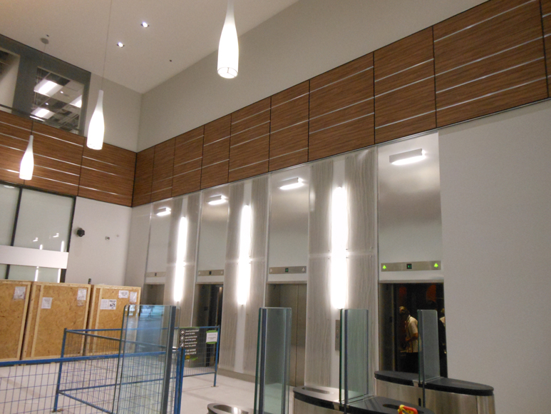 High-rise elevator lobby finishes really help to brighten a once dark space.