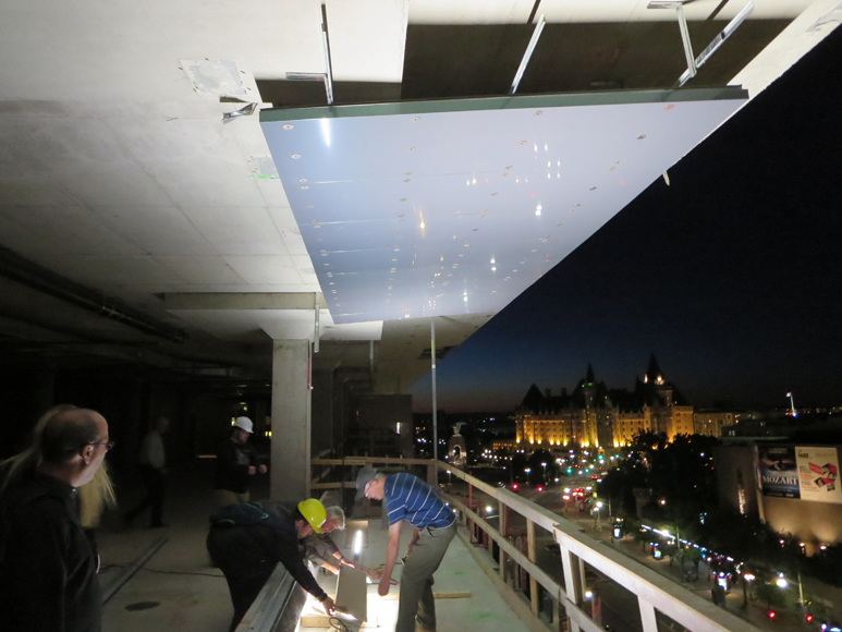 Here is the mock-up at the 8th floor.  You can see the reflective soffit and the light fixture being adjusted.